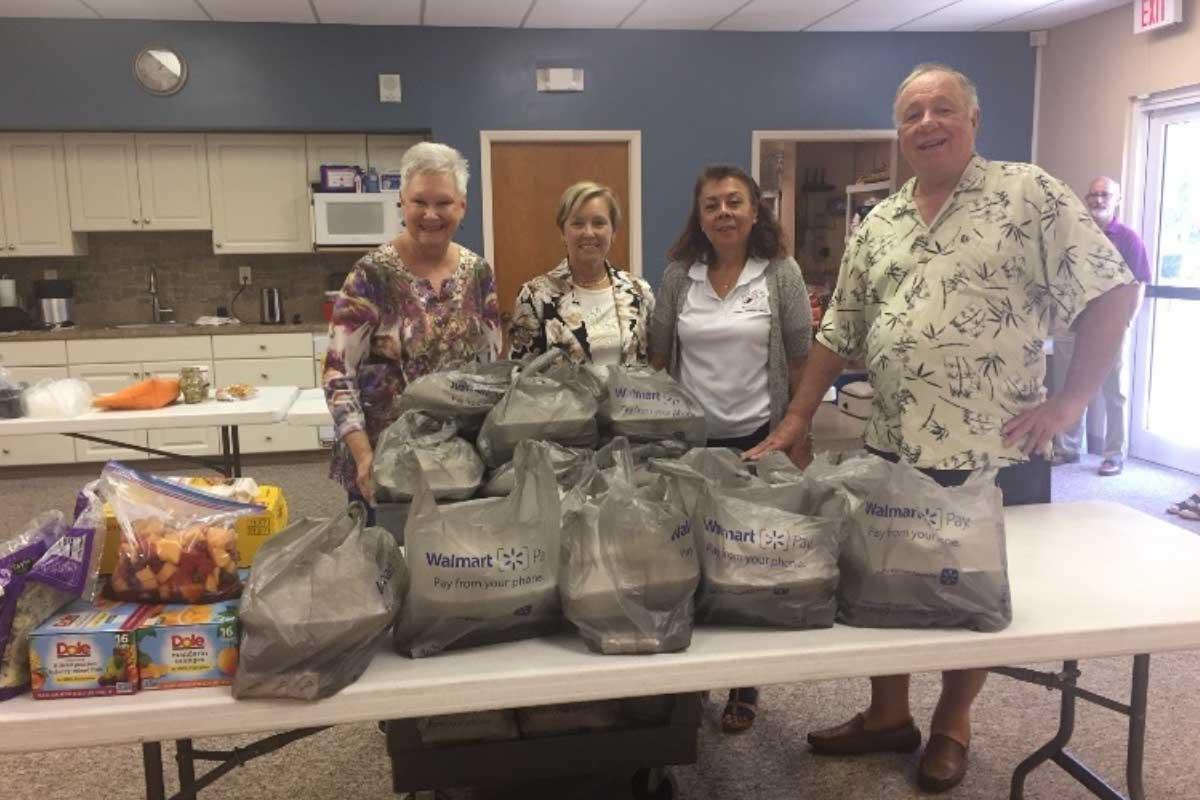 Senior Ministry members with food donations   Christus Victor Lutheran Church Naples & Bonita Springs