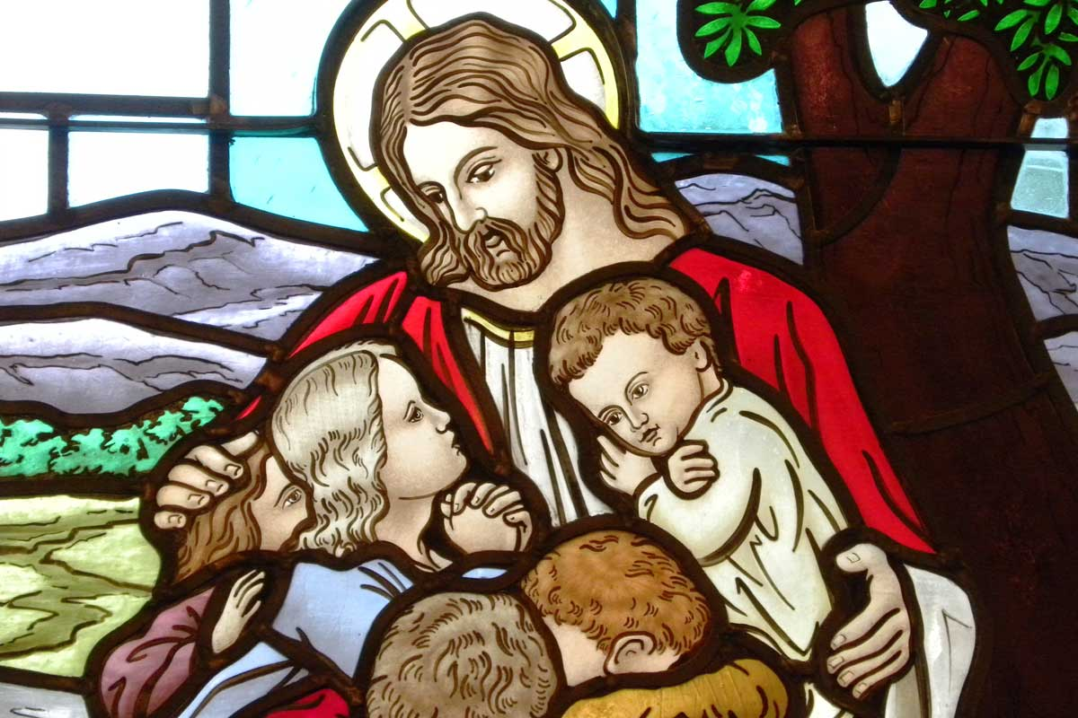 Stained glass window with portrait of Christ and the church's youth | Christus Victor Lutheran Church Naples & Bonita Springs