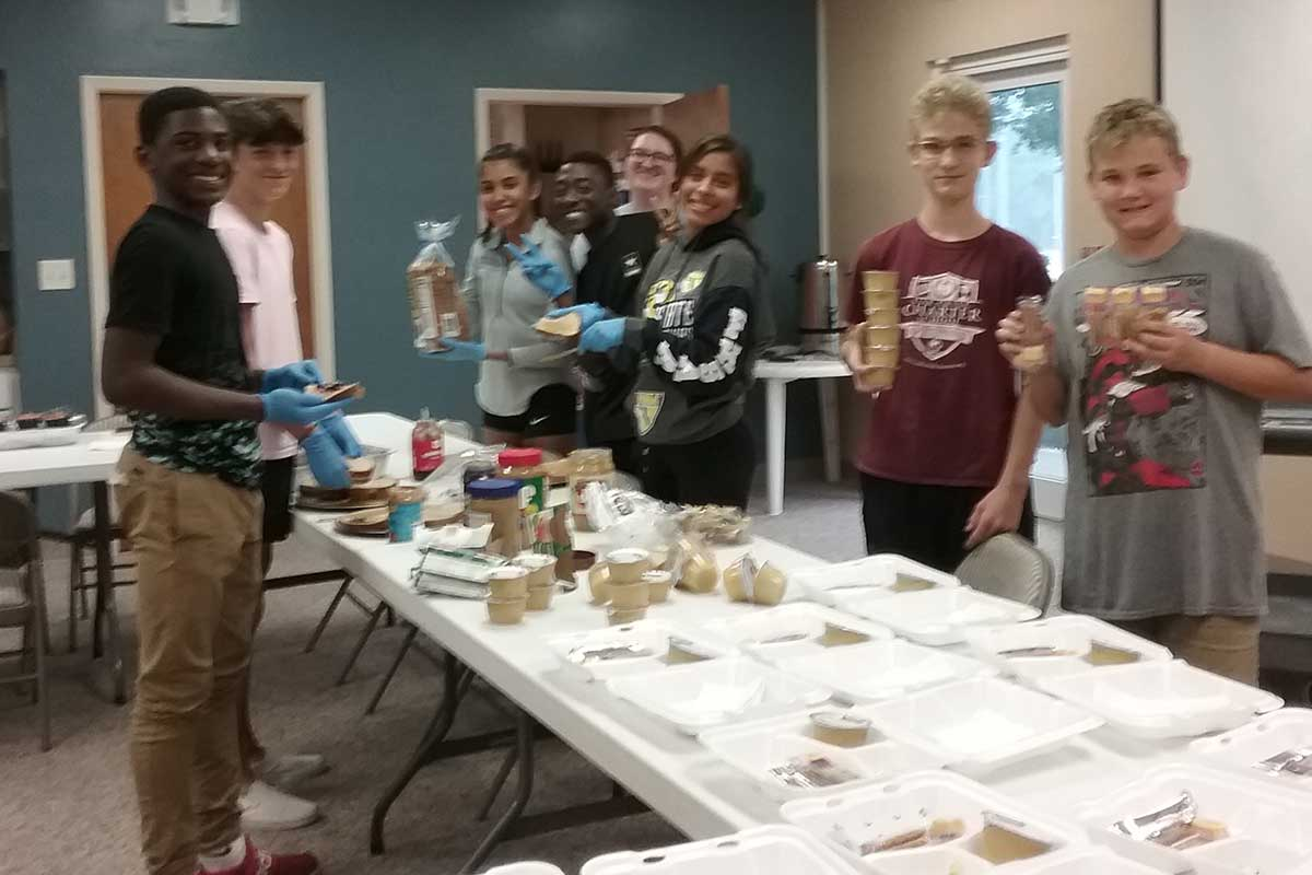 CVLC's Youth Group packing meals for donation | Christus Victor Lutheran Church Naples & Bonita Springs
